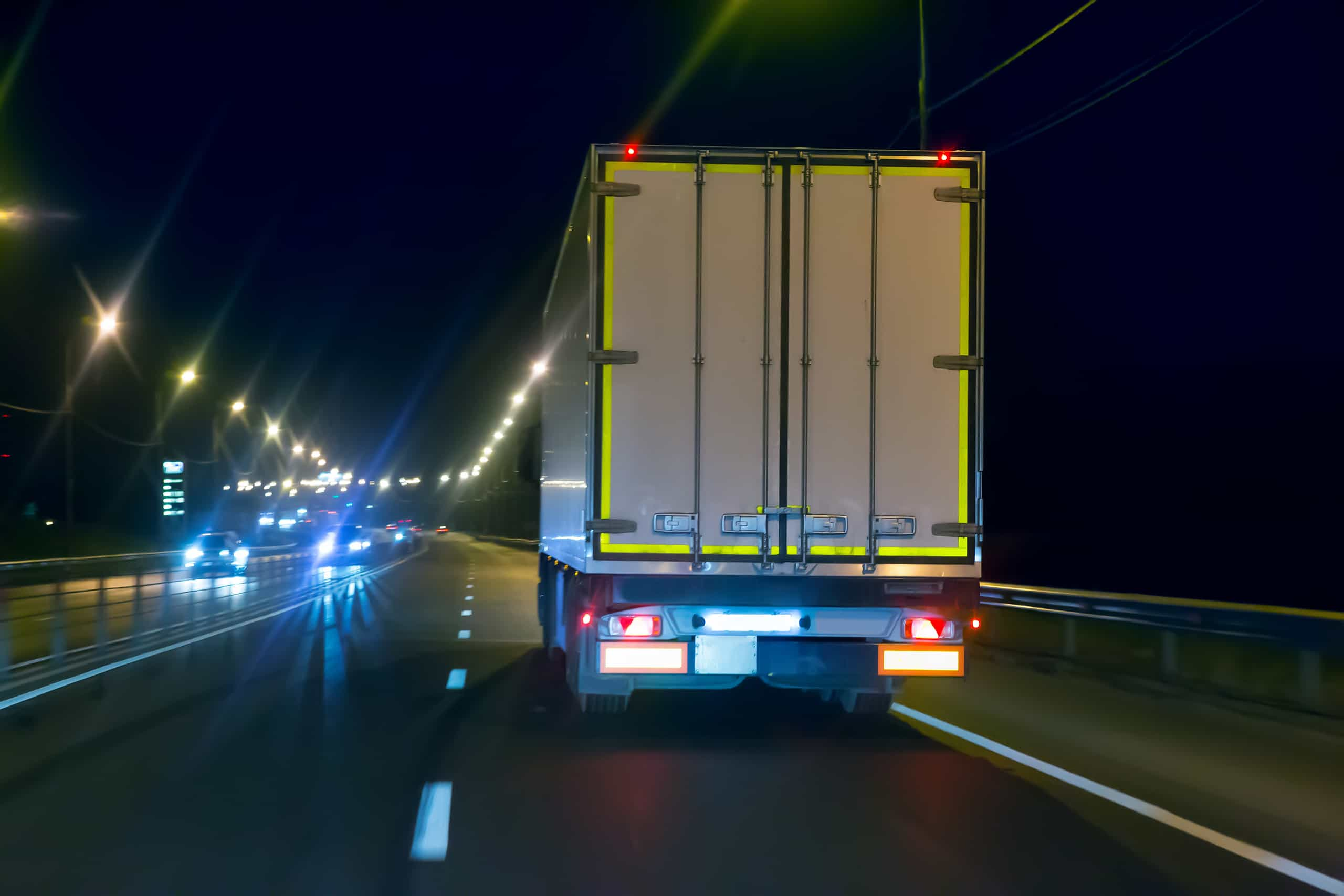 truck moves on country highway at night